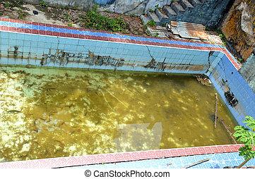unused swimming pool - an empty unused swimming pool