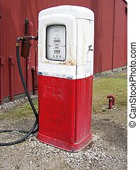 Retro Gas Pump - Retro gasoline pump on a farm.