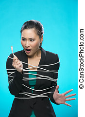 Asian woman tangled up in computer network cable.