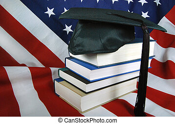 American Graduate - Graduation cap on a stack of school...