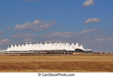 Denver International Airport rises like a white mountain...