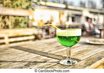 Berliner Weisse in green ordered in a beergarden at a sunny...