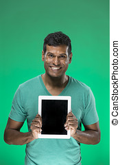 Indian man using a tablet PC - Cheerful Indian man using a...