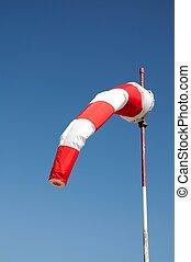 Red and white windsock. - Red and white windsock in a light...