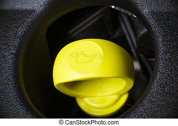 Engine oil dipstick. - Yellow Engine oil dipstick in...