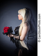 black widow in grief with flowers with a veil on a black...