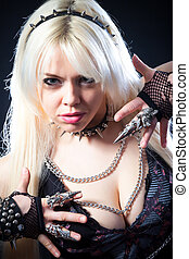 attractive woman with blade metal claw, studio shot