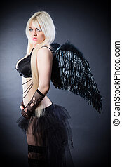 Blond female angel with black wings on a black background -...