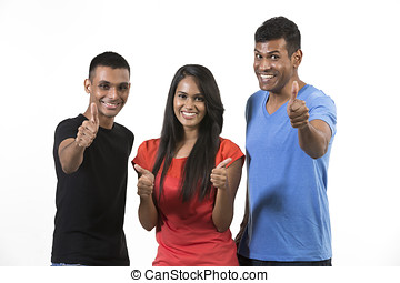 Happy group of Indian friends with thumbs up. isolated over...