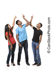 Group of happy Indian friends pointing upwards.