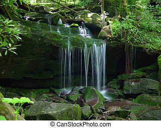 Small Waterfall - A small water fall flows on a rock ledge