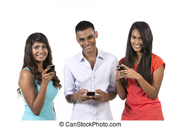 Group of young Indian friends using their smartphones Happy...