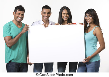 Group of Indian people with a banner ad. Isolated on white...
