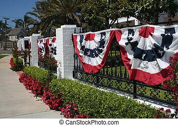 Patriotic Display - Red, White, and Blue banners hang on a...