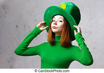 Red hair girl in Saint Patrick's Day leprechaun party hat...