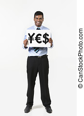 Indian business man holding currency symbols saying word YES...