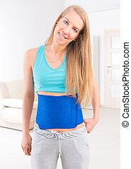 Woman wearing slimming belt - Beautiful young woman wearing...