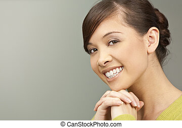 Beautiful Smile - A beautiful young oriental woman with a...