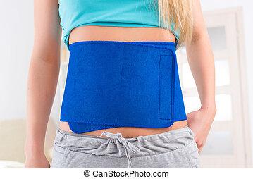 Woman wearing slimming belt - Woman wearing neoprene...
