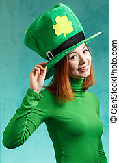 Red hair girl in Saint Patricks Day leprechaun party hat -...