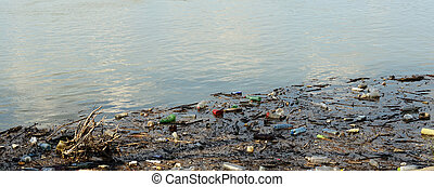 Dirty river - Plastic bottles and other garbage pollute the...