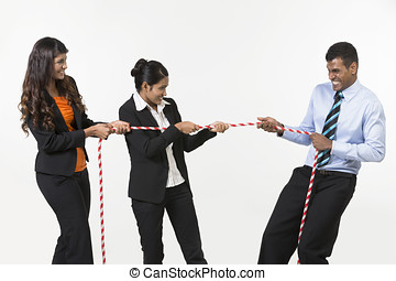 Three Indian business people playing tug war. Isolated on...