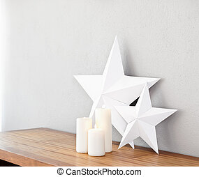 stars and candles - Stars and lit candles on a side board as...