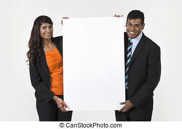 Two Happy Indian Business People Holding Placard Isolated on...
