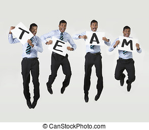 Happy Indian business man holding sign spelling team - happy...