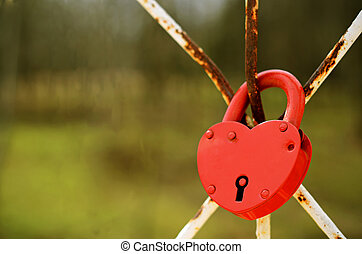 Red heart shaped lock holds the marriage bond by Russian...