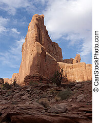 Partly Cloudy - Red rock formation against partly cloudy sky...