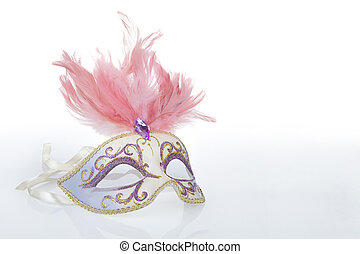 Beautiful carnival mask with pink feathers and a reflection