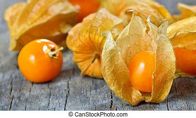 Physalis fruit on old wood