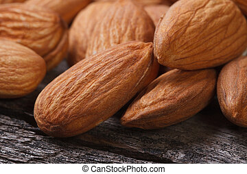 whole almonds close up on an old wooden table