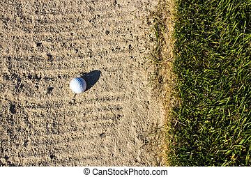 Golf ball in the sand trap