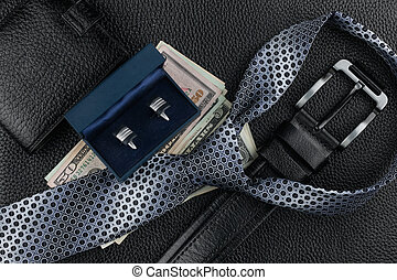 Tie, belt, wallet, cufflinks, money lying on the skin, can...