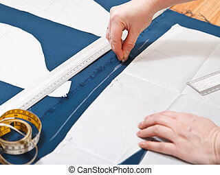 drawing of pattern for cutting dress from blue fabric