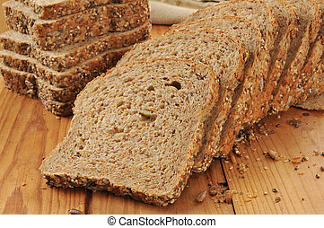 Sprouted grain and seed bread - A sliced loaf of sprouted...