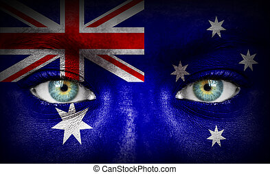 Human face painted with flag of Australia