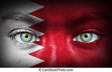 Human face painted with flag of Bahrain