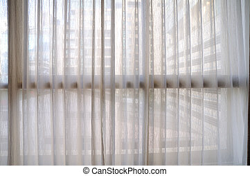 Classic see through white curtain.