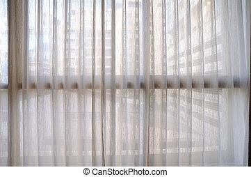 Classic see through white curtain.
