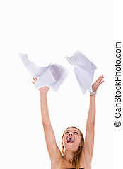 girl throwing papers in the air