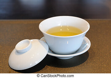 Chinese tea cup on luxury napery.