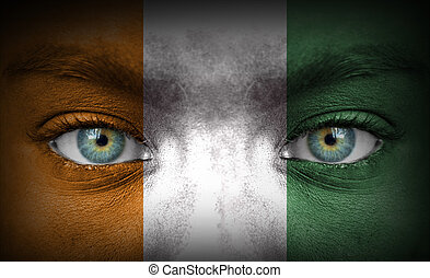 Human face painted with flag of Ivory Coast