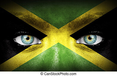 Human face painted with flag of Jamaica