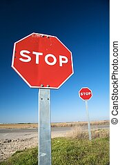 couple of stop traffic signs - stop traffic sign next to...