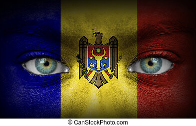 Human face painted with flag of Moldova