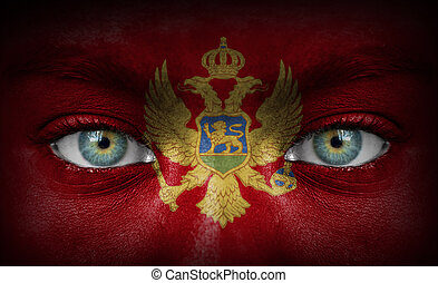 Human face painted with flag of Montenegro