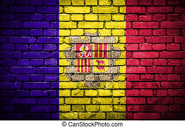 Brick wall with painted flag of Andorra